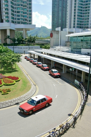panning shot: red taxi in hongkong