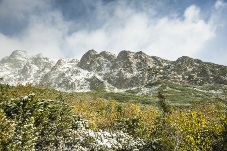 yelloow: winter is coming into mountains Stock Photo
