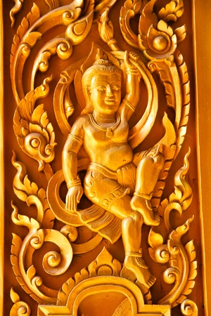 Carved wood thai temple photo
