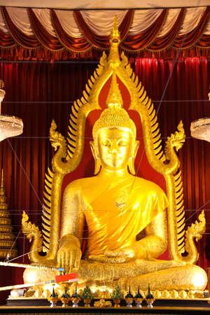 Buddha statue, Prajaoyaiinplang, Wat Mahawanaram, Ubonratchathatni, Thailand photo