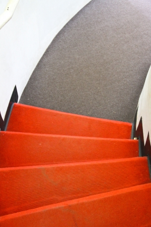 Red and gray carpet on stair photo