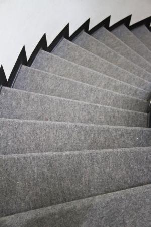 gray carpet on stair Фото со стока