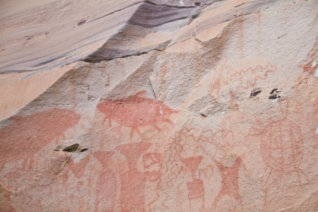 painting on stone wall be prehistoric drawing age about 3,000 year, at patam of ubonratchathani thailand