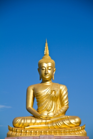 buddha statue on blue sky background photo