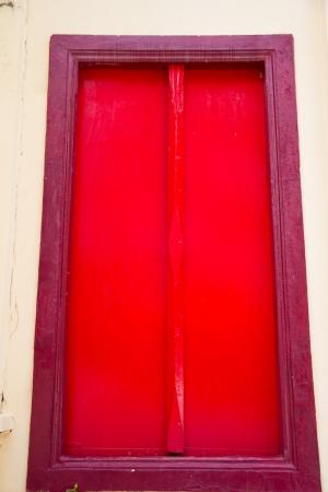 Thai temple red door at Ubonratchathani Thailand photo