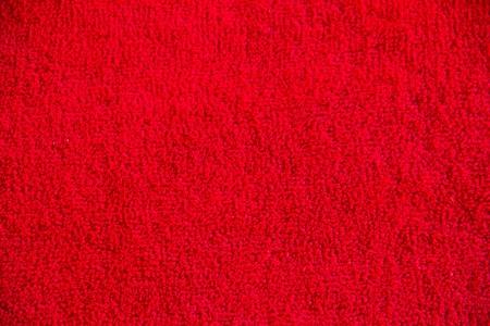 burgundy background: Red carpet Stock Photo