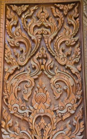 Carving wood in thai temple photo