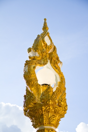 golden naga lighting in thai temple photo