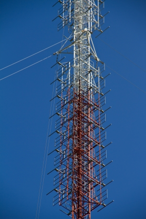 Stock Photo  communications tower with antennas against blue sky  photo