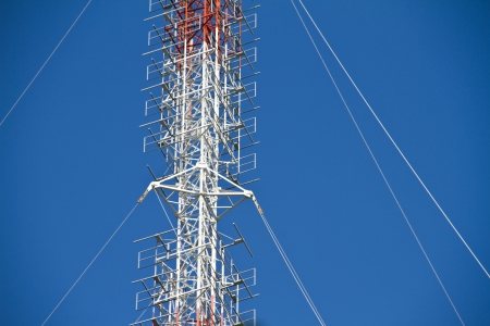 Communication Tower with white blue sky photo
