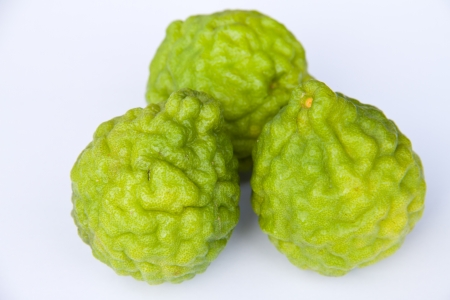 Kaffir limes on white background  photo