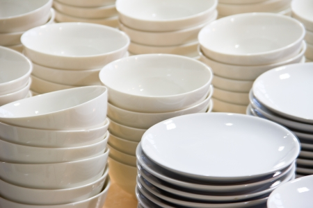 Stacked white dishes photo