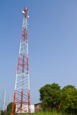 comunication: communications tower with antennas against blue sky