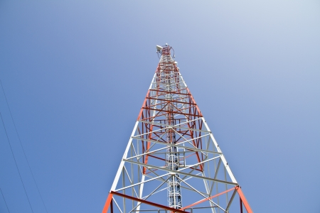 telco: Mobile tower communication antennas with blue sky background Stock Photo