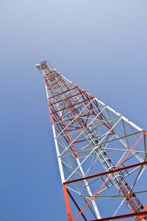 Mobile tower communication antennas with blue sky background Stock Photo