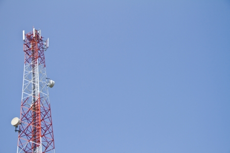 comunication: Mobile tower communication antennas with blue sky background Stock Photo
