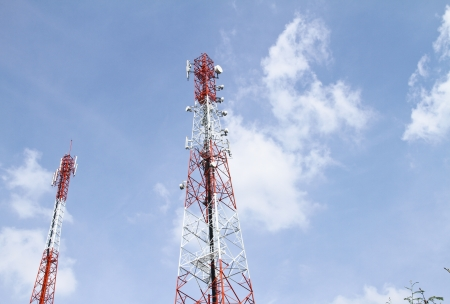 Mobile tower communication antennas with blue sky background photo