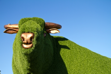 munch: Statue of a bull with artificial green grass Stock Photo
