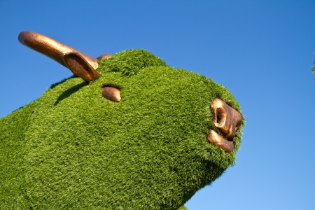 Statue of a bull with artificial green grass photo