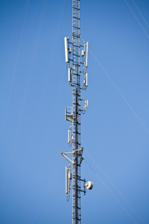 telecommunications tower with a blue sky photo