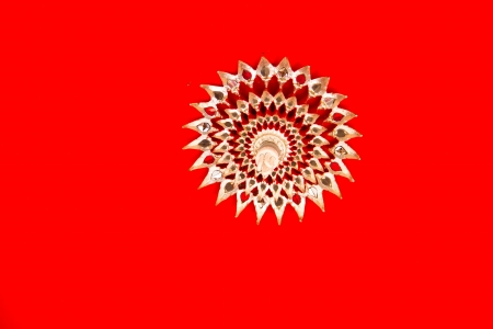 Thai temple ceiling on red background Stock Photo - 17441019