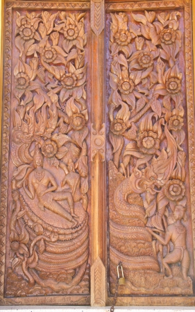 Wood carving decorated at windows of the temple Stock Photo - 17594197