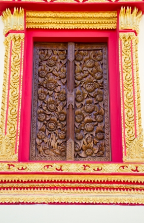 Wood carving decorated at windows of the temple Stock Photo - 17594198