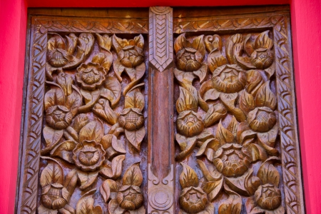 Wood carving decorated at windows of the temple Stock Photo - 17594209