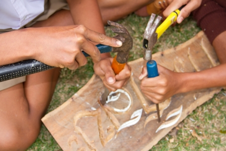 thai student: Thai student carving wood with care Stock Photo