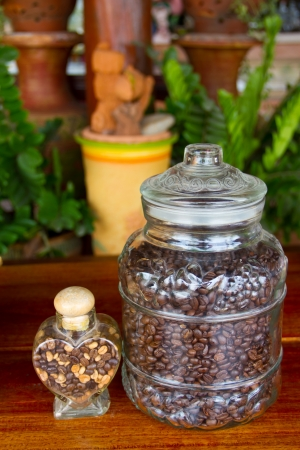 Glass jar with coffee beans photo