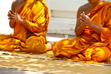 monks and religious rituals in thai temple photo