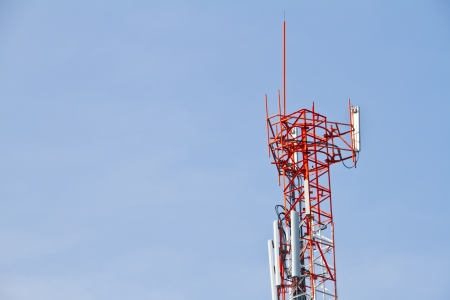 Communication Tower on blue sky background photo