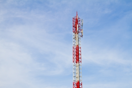 Communication Tower on blue sky background photo