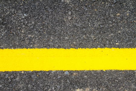 New asphalt texture with yellow line photo