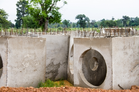 Concrete drainage pipes on construction site  photo