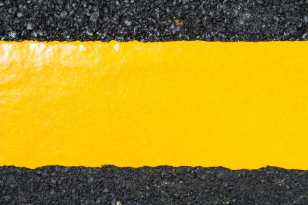 Yellow line on new asphalt photo