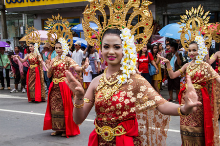 Thai lady dance in candle festival at thailand