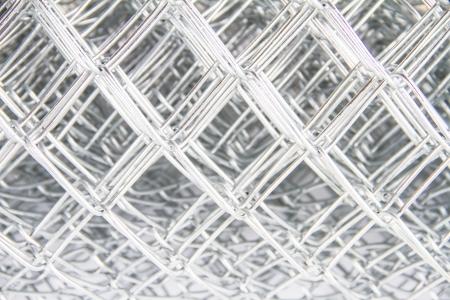 Wire mesh on white background photo