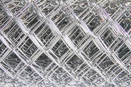 Rete metallica su sfondo bianco Archivio Fotografico - 24432187