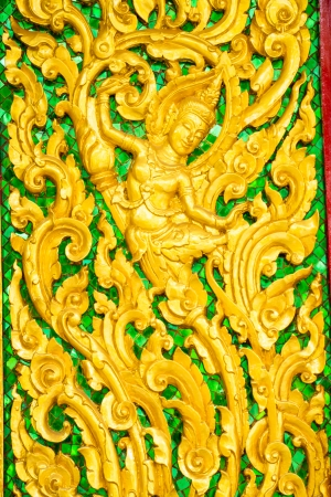 Thai style Carving door temple photo