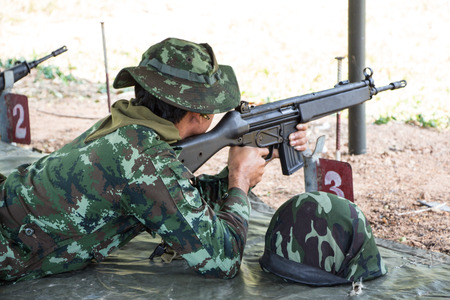 Soldiers firing rifle