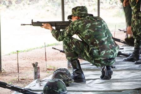 soldier shooting of rifle