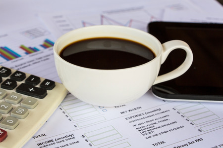 Business report with cup of coffee photo