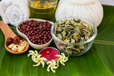 Thai herb for spa on green leave natural background photo