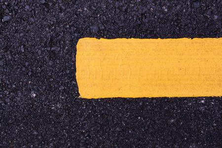 New asphalt texture with yellow line photo