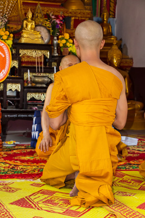 make belief: New monk in Thai temple Stock Photo