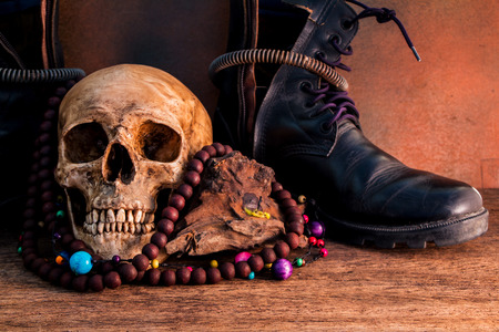 shoe strings: Skull with combat still life Stock Photo