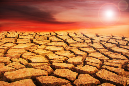 mire: Dry crack earth with the sun Stock Photo