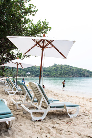 idling: White umbrella on the beach