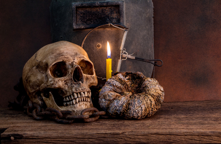 Skull with candle light still life Stock Photo